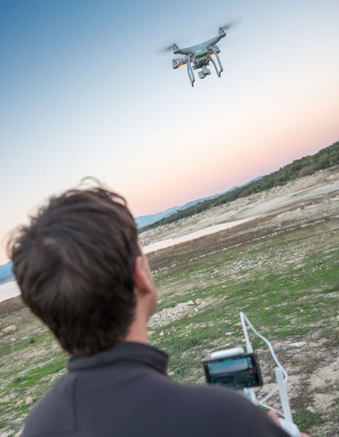 Man Piloting Drone