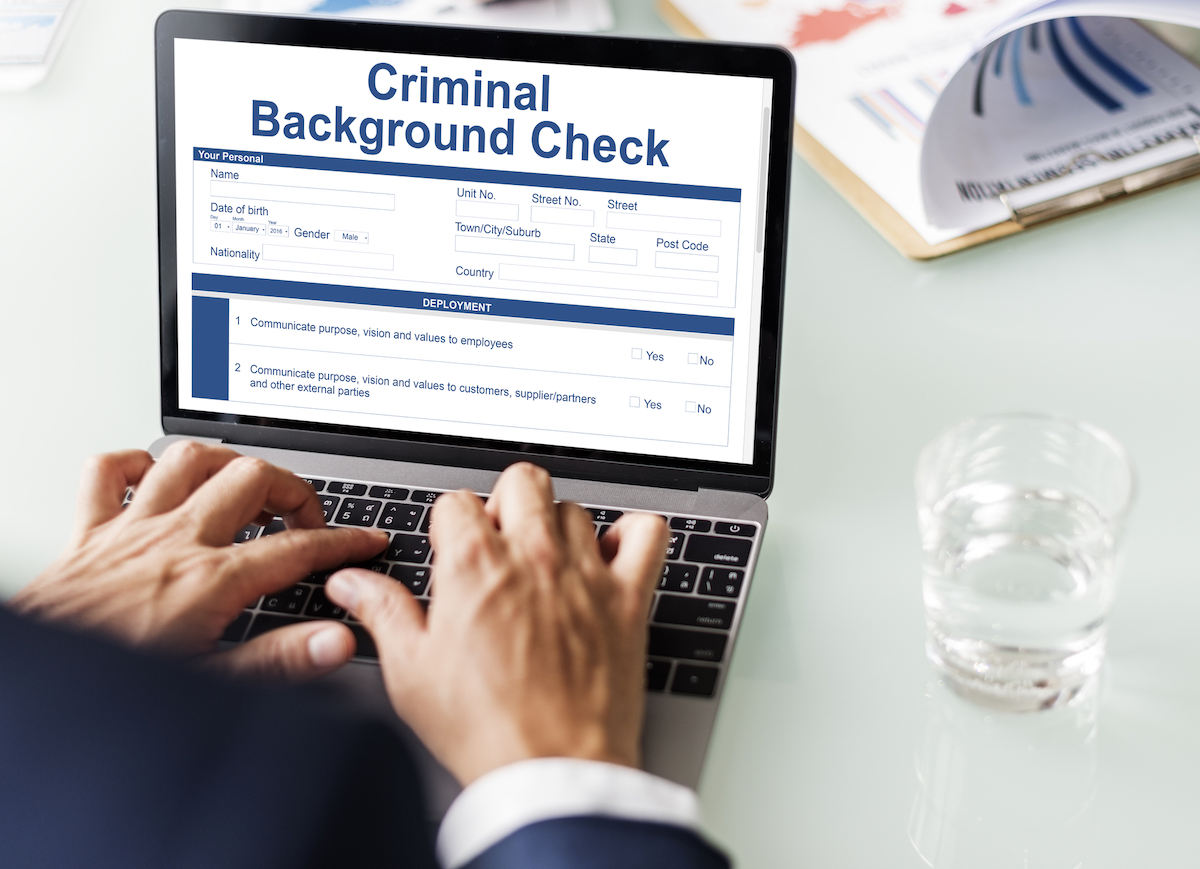 Searching Criminal Background Check on Laptop